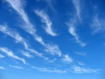 De wolken van Wispy Stock Foto's