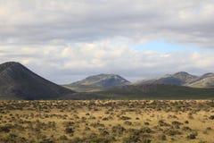 De wolkenhemel van heuvelsvlaktes stock afbeelding