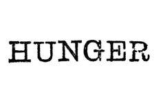 De woord` HONGER ` van een schrijfmachine op wit royalty-vrije stock foto