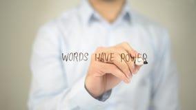De woorden hebben Macht, mens die op het transparante scherm schrijven Royalty-vrije Stock Foto's