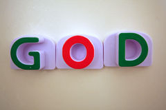 De woordGOD in groen en rood Stock Fotografie