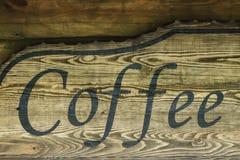 De woordkoffie op oude houten achtergrond Royalty-vrije Stock Foto