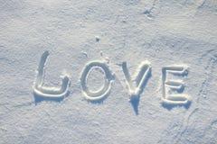 De woordliefde die in de sneeuw wordt getrokken Royalty-vrije Stock Afbeeldingen