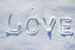 De woordliefde die in de sneeuw wordt getrokken Royalty-vrije Stock Fotografie