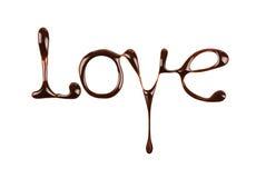 De woordliefde door vloeibare chocolade op wit wordt geschreven dat Stock Foto's