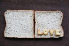De woordliefde op brood Stock Foto