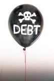 De woordschuld in wit en schedel en dwarsbeenderen op een ballon die het concept een schuldbel illustreren Royalty-vrije Stock Afbeeldingen