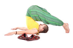 De yoga Halasana stelt Stock Afbeelding
