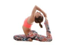 De yoga stelt radjakapotasana van ekapada Stock Fotografie