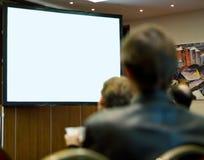 De zaalhoogtepunt van de conferentie van mensen het deelnemen Royalty-vrije Stock Afbeelding