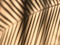 De zachte nadruk van het palmbladsilhouet op ruwe lichtoranje achtergrond Het zonlicht door groen blad en overdenkt muur om zwart royalty-vrije stock afbeelding