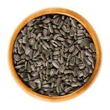 De zaden van de zonnebloem in houten kom Royalty-vrije Stock Fotografie