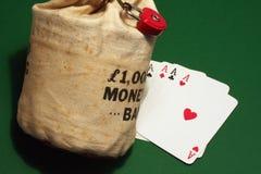 De zak en de azen van het geld Royalty-vrije Stock Foto's