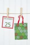 De Zak van de gift en de Pagina van de Kalender van Kerstmis Royalty-vrije Stock Afbeelding