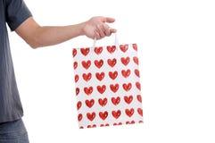 De zak van de valentijnskaart in een hand Royalty-vrije Stock Afbeelding