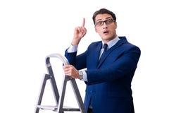 De zakenman boven ladder op witte achtergrond wordt geïsoleerd die royalty-vrije stock afbeeldingen