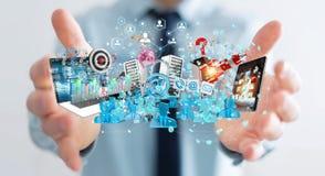 De zakenman die apparaten aansluiten en zaken heeft samen bezwaar 3D Stock Afbeeldingen