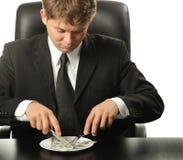 De zakenman die dinerdollars heeft stock afbeelding