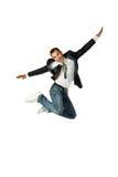 De zakenman die op een witte achtergrond springt Stock Foto's