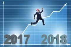 De zakenman die in santahoed vanaf 2017 tot 2018 springen Stock Foto