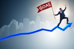 De zakenman die zijn bedrijfsdoelstellingen en doelstellingen bereiken Stock Foto's