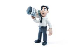 De zakenman draagt een gevouwen dollar Stock Fotografie