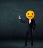 De zakenman draagt geel smileygezicht Stock Afbeeldingen