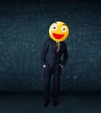 De zakenman draagt geel smileygezicht Stock Foto
