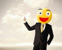 De zakenman draagt geel smileygezicht Stock Afbeelding