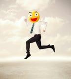 De zakenman draagt geel smileygezicht Royalty-vrije Stock Afbeeldingen