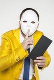 De zakenman in een gouden kostuum, voert stil gebaar uit stock afbeelding