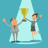 De zakenman en het jonge meisje houden trofeewinnaar Stock Afbeelding