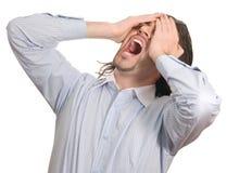 De zakenman geeft aan zijn geïsoleerdee wanhoop uiting Stock Foto