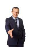 De zakenman geeft een handdruk Stock Afbeeldingen