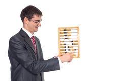 De zakenman gelooft in de rekeningen Royalty-vrije Stock Afbeelding