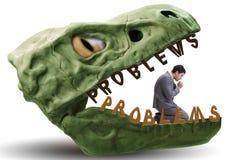 De zakenman in de kaken van problemen stock foto's