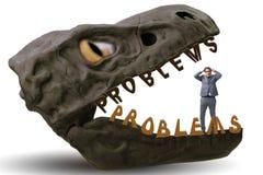 De zakenman in de kaken van problemen stock afbeelding