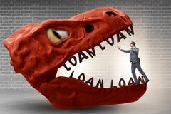 De zakenman in de kaken van schuld en lening royalty-vrije stock afbeeldingen