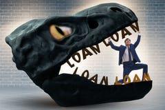 De zakenman in de kaken van schuld en lening royalty-vrije stock afbeelding
