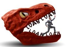 De zakenman in de kaken van schuld en lening stock foto