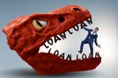 De zakenman in de kaken van schuld en lening stock fotografie