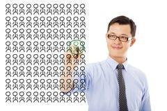 De zakenman kiest een talent of een juiste persoon stock afbeelding