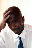 De zakenman kijkt droevig Stock Afbeelding