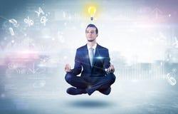 De zakenman mediteert met verlichtingsconcept royalty-vrije stock foto's