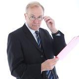 De zakenman met beoordeling kijkt stock fotografie