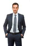 De zakenman met dient zijn zakken in Stock Foto