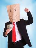 De zakenman met een document zak met glimlach op hoofd houdt geld in zijn hand Royalty-vrije Stock Afbeeldingen