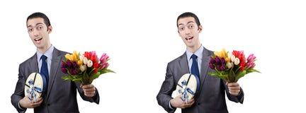 De zakenman met giftbox en bloemen Royalty-vrije Stock Afbeeldingen