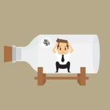 De zakenman neemt in fles in beslag Stock Foto