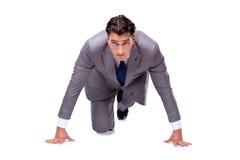 De zakenman op begin klaar voor lopen geïsoleerd op wit stock foto